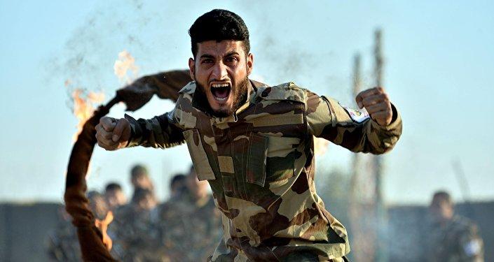 Türkiye'de eğitilen ÖSO militanları görüntülendi