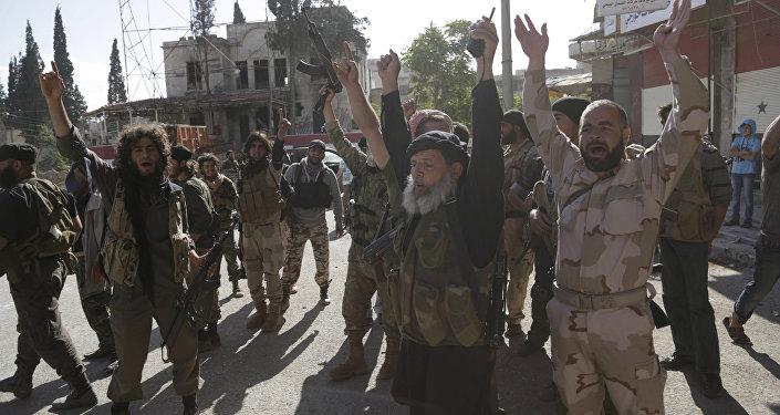 Kaide kolu Nusra militanlarının 2019'te İdlib'in Eriha bölgesini ele geçirdiklerindeki zafer gösterisi