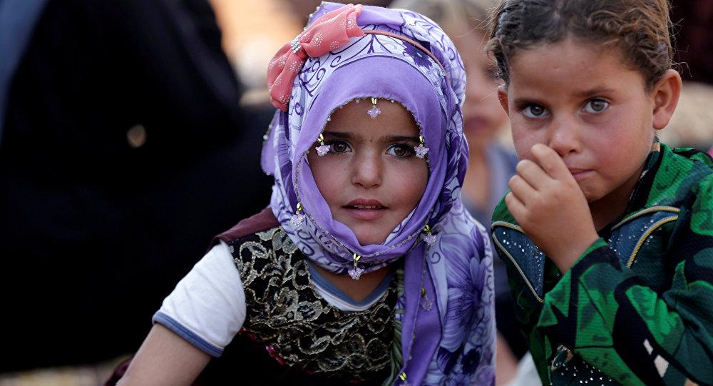Reyhanlı'ya bakan İdlib'in Atme kasabasındaki sığınnmacı kampında çocuklar