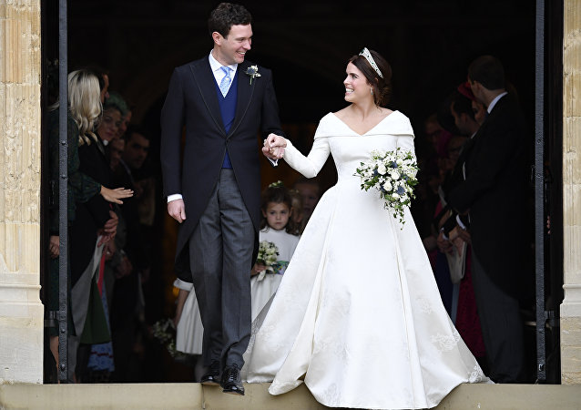 Britain's Princess Eugenie and Jack Brooksbank leave St George's Chapel after their wedding at Windsor Castle, near London, England, Friday Oct. 12, 2018.