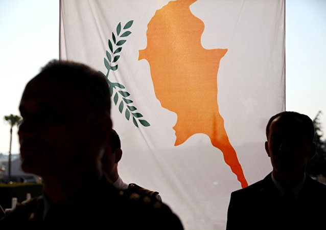 The Greek Cypriot flag hangs during a memorial ceremony at the Tymvos of Makedonitissas in Nicosia, Cyprus.