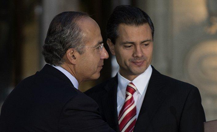 Meksika Devlet Başkanı Pena Nieto ve bir önceki Başkan Felipe Calderon