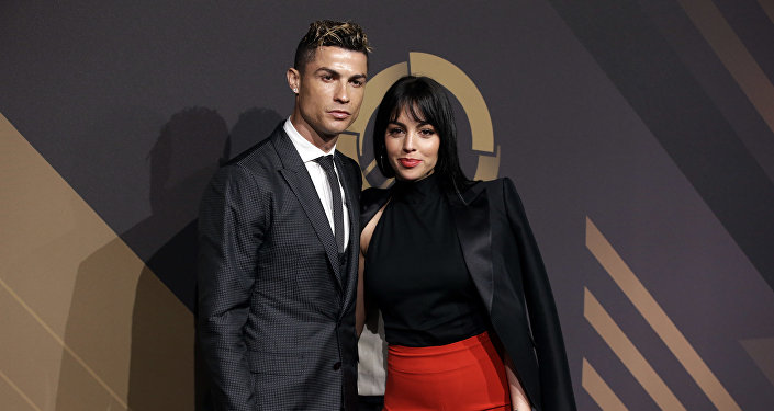 In this March 19, 2018 file photo, Real Madrid player Cristiano Ronaldo and his girlfriend Georgina Rodriguez pose for photos as they arrive for the Portuguese soccer federation awards ceremony in Lisbon