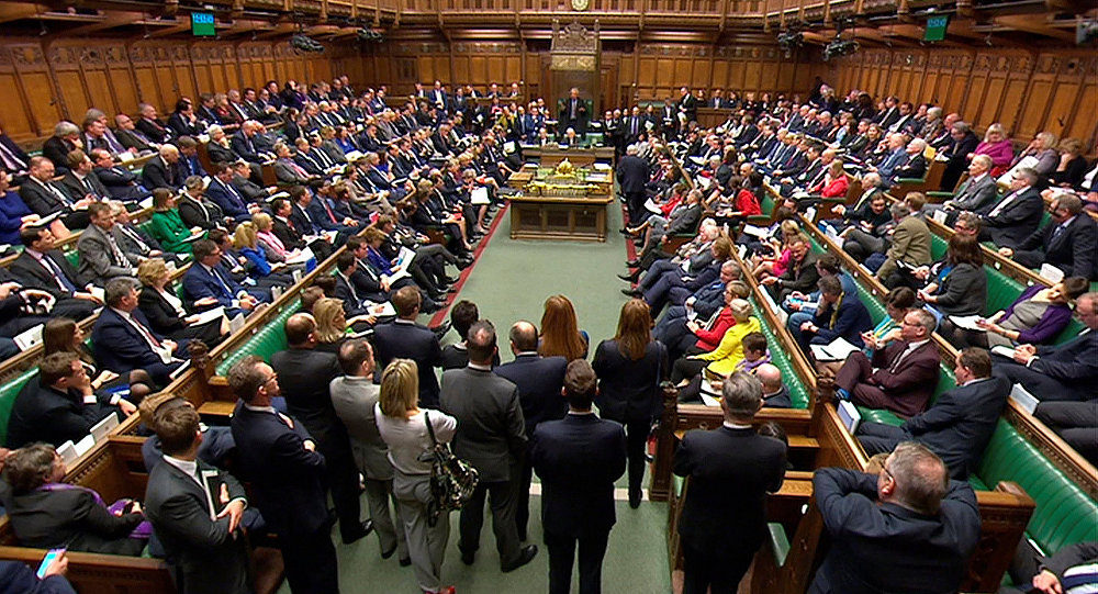 Britain's Prime Minister Theresa May addresses the House of Commons on her government's reaction to the poisoning of former Russian intelligence officer Sergei Skripal and his daughter Yulia in Salisbury, in London, March 14, 2018