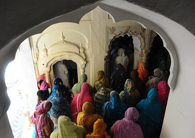 Sikh women pilgrims stand during a religious ceremony at Gurdwara Dera Sahib in Lahore on June 16, 2011