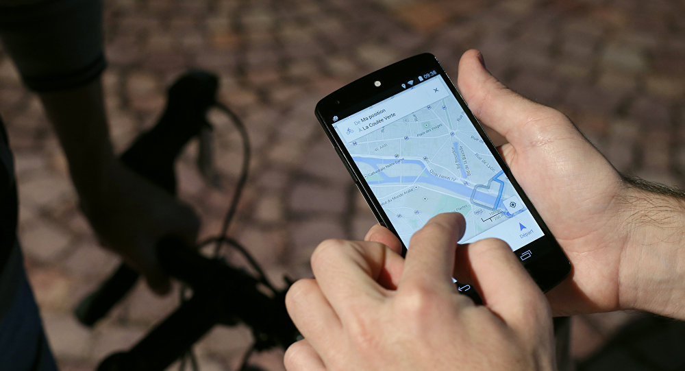 A man uses a GPS app on a smartphone during a Google promotion event