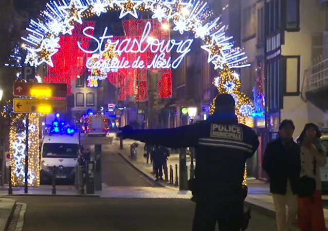 In this image made from video, emergency services arrive on the scene of a Christmas market in Strasbourg, France, Tuesday, Dec. 11, 2018