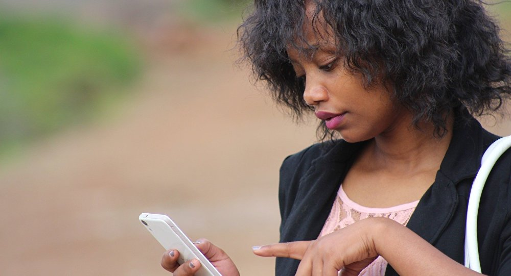 A woman using her smartphone