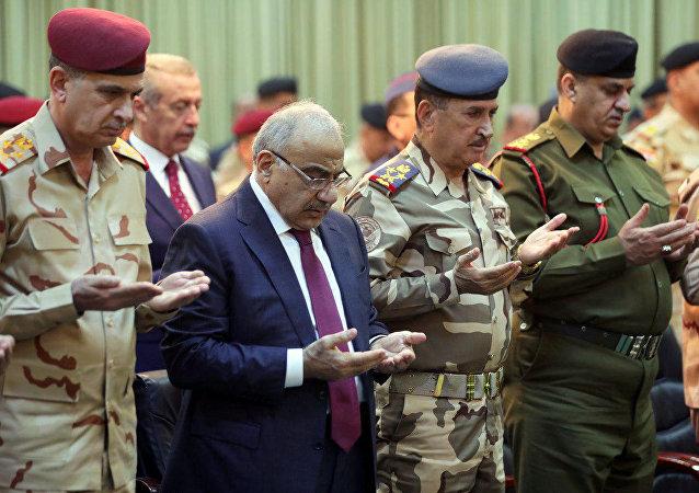 IŞİD'in yenilgiye uğratılmasının 1. yıldönümü için 10 Aralık 2018'de Bağdat'ta düzenlenen törenlerde Irak Başbakanı Adil Abdulmehdi ile komutanlar