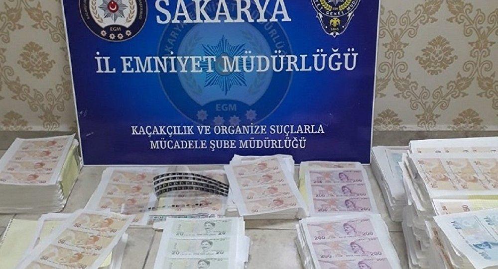 Sakarya'da yaklaşık 2 milyon lira değerinde sahte banknot ele geçirildi