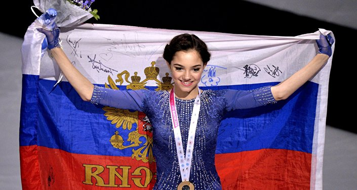 Russia's Yevgeniya Medvedeva, winner of the gold medal in the women's free program competition at the ISU Grand Prix of Figure Skating Final in Barcelona, during the medal ceremony