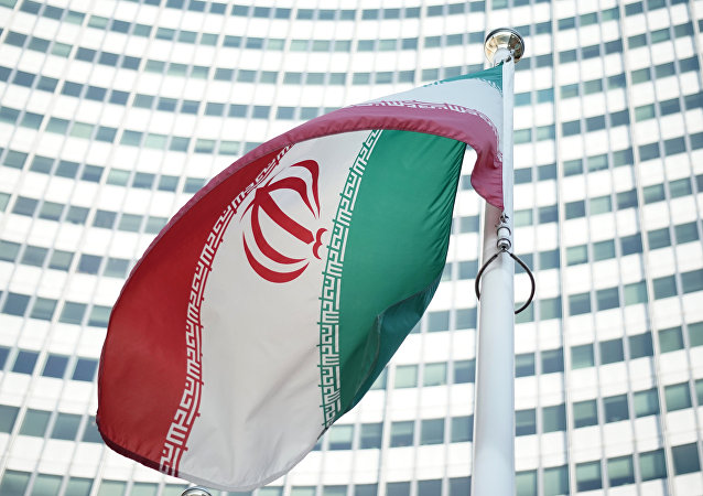 An Iranian flag waves in a wind outside the Vienna International Centre hosting the United Nations (UN) headquarters and the International Atomic Energy Agency (IAEA) as the socalled EU 5+1 talks with Iran take place in Vienna, on July 3, 2014.