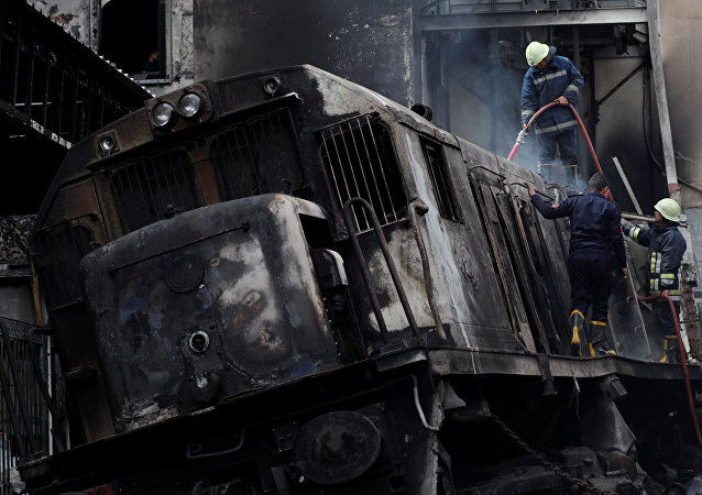 Rescue workers put out a fire at the main train station in Cairo, Egypt, February 27, 2019