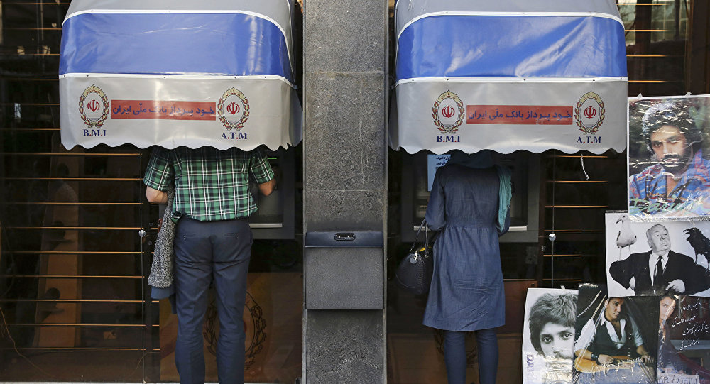 Iranians use ATM machines of Bank Melli Iran in downtown Tehran, Iran (File)