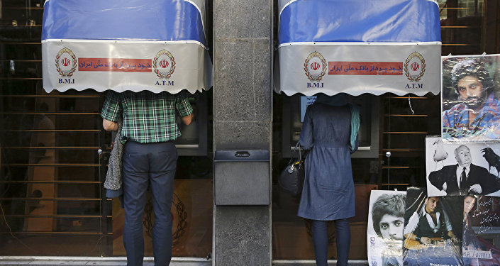 Iranians use ATM machines of Bank Melli Iran in downtown Tehran, Iran (File)