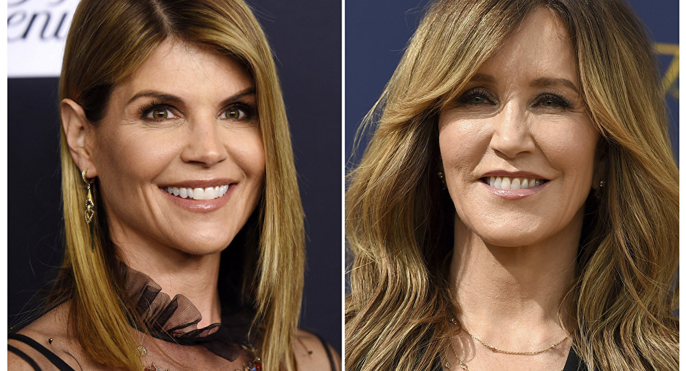 This combination photo shows actress Lori Loughlin at the Women's Cancer Research Fund's An Unforgettable Evening event in Beverly Hills, Calif., on Feb. 27, 2018 left, and actress Felicity Huffman at the 70th Primetime Emmy Awards in Los Angeles on Sept. 17, 2018