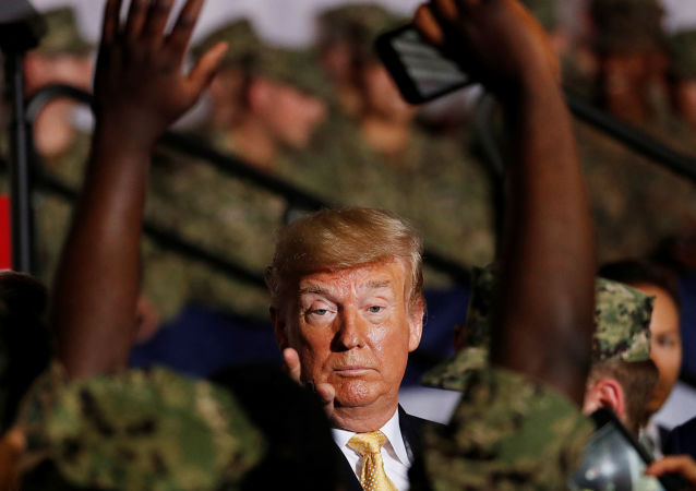 U.S. President Donald Trump interacts with military personnel aboard the USS Wasp as he participates in a Memorial Day Address in Yokosuka, south of Tokyo, Japan May 28, 2019. REUTERS/Issei Kato