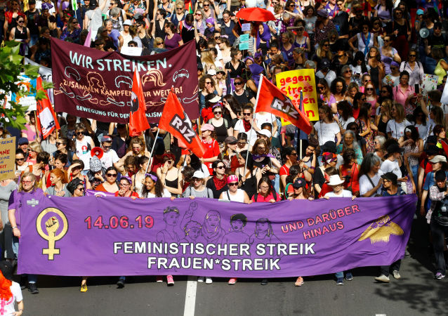 Protesters carry banners and placards at a demonstration during a women's strike (Frauenstreik) in Zurich, Switzerland June 14, 2019. REUTERS/Arnd Wiegmann