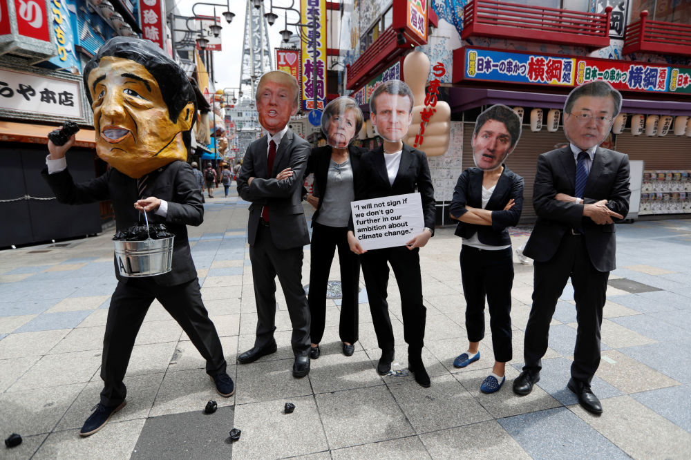 G20 Liderler Zirvesi'nin düzenlendiği Osaka kentinde protesto gösterisini yapan eylemciler.