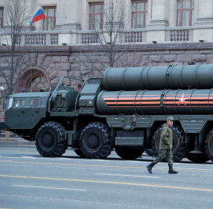 FILE PHOTO: A Russian serviceman walks past S-400 missile air defence systems before a parade marking the anniversary of the victory over Nazi Germany in World War Two, in central Moscow, Russia April 29, 2019. REUTERS/Tatyana Makeyeva/File Photo