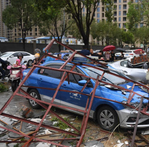 Cars are damaged after typhoon Lekima made landfall in Wenling, Zhejiang province, China August 10, 2019. Wang Gang/CNS via REUTERS ATTENTION EDITORS - THIS IMAGE WAS PROVIDED BY A THIRD PARTY. CHINA OUT.