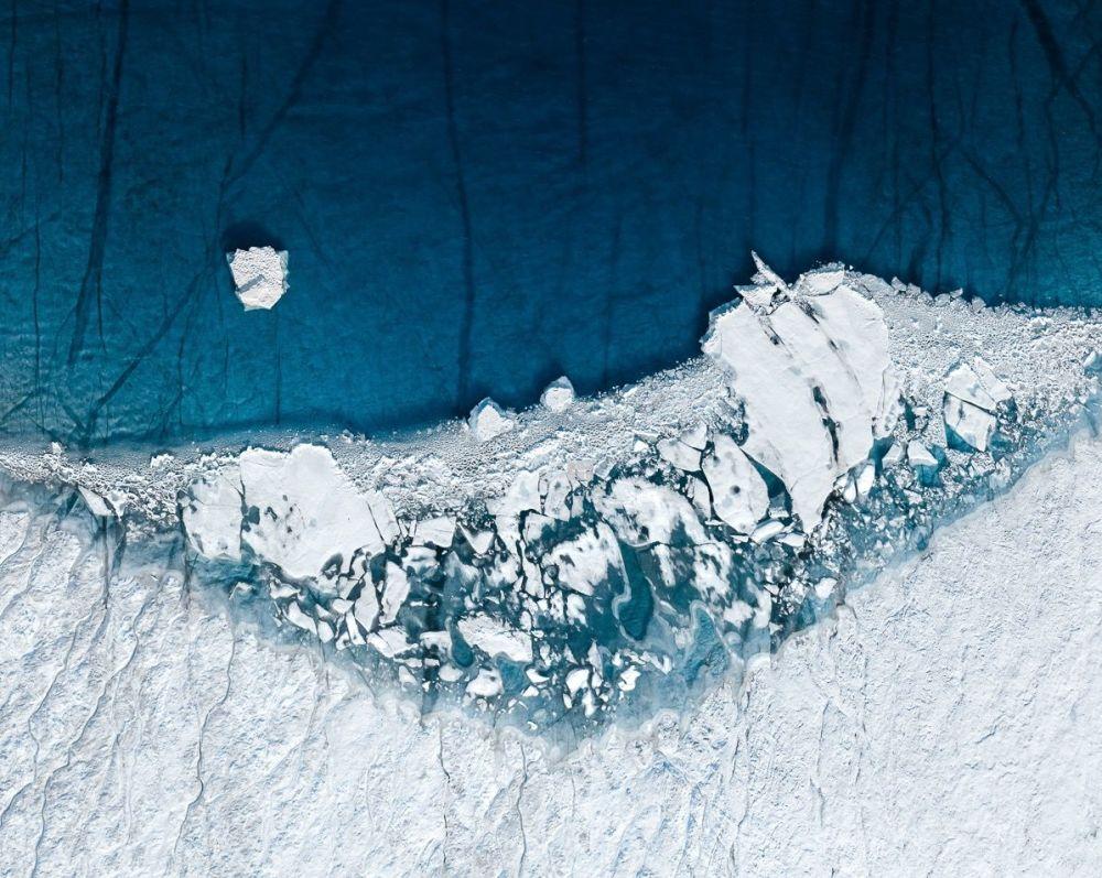 Hegen, bir fotoğrafçı olarak insan ve doğa arasındaki ilişkiyi odağına alıyor. Fotoğrafta: Grönland'da küresel ısınmanın etkisiyle eriyen buz tabakası.