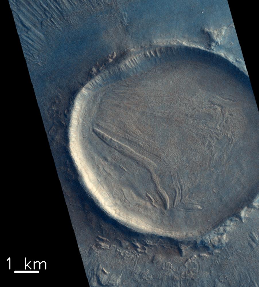 Trace Gas Orbiter uzay aracı tarafından görüntülenen Mars yüzeyindeki krater.
