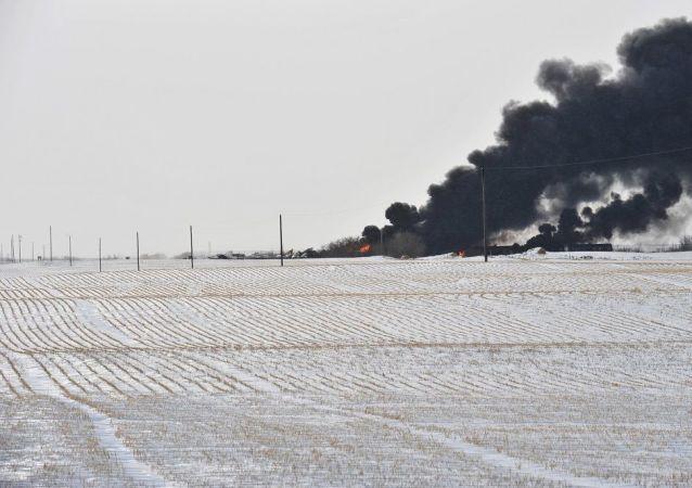 A smoke rises from a fire at the site of a CP Rail train car derailment near Guernsey, Saskatchewan,