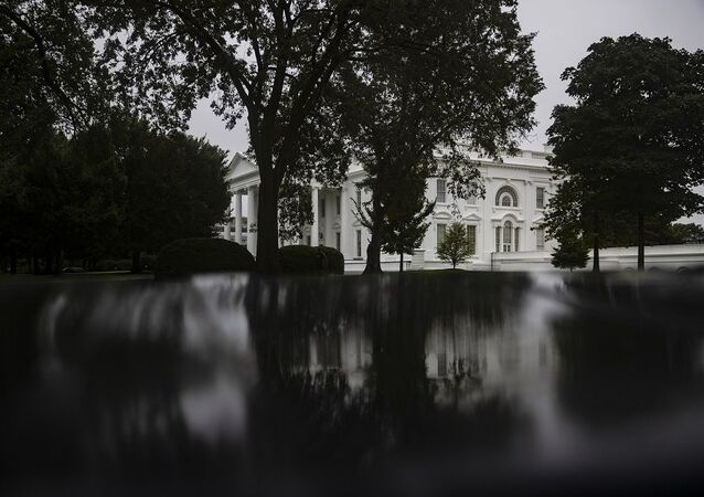 The White House is reflected in a puddle on August 29, 2020 in Washington, DC, -