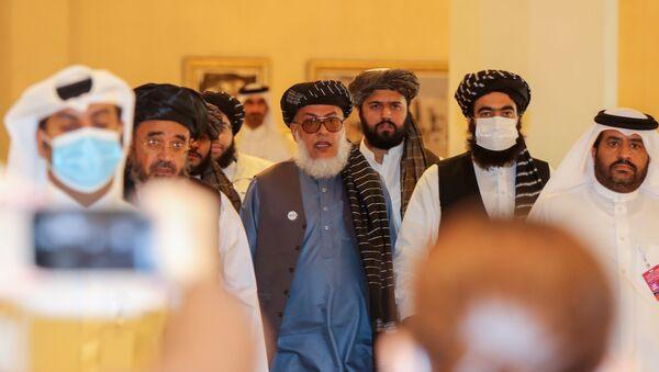 Afganistanhükümetinden temsilciler ile müzakerelere başlayan Taliban üyeleri  - Sputnik Türkiye