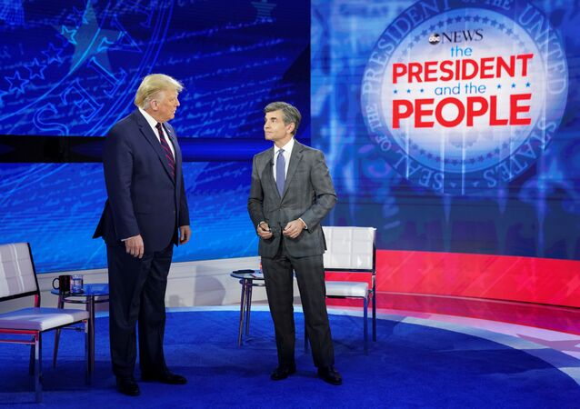 U.S. President Donald Trump takes the stage with ABC News chief anchor George Stephanopoulos for a town hall event in Philadelphia, Pennsylvania, U.S., September 15, 2020. REUTERS/ Kevin Lamarque