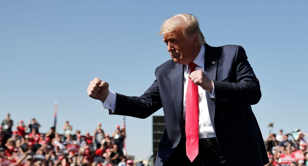 U.S. President Donald Trump gestures as he attends a campaign rally at Prescott Regional Airport in , Arizona, U.S., October 19, 2020. REUTERS/Carlos Barria