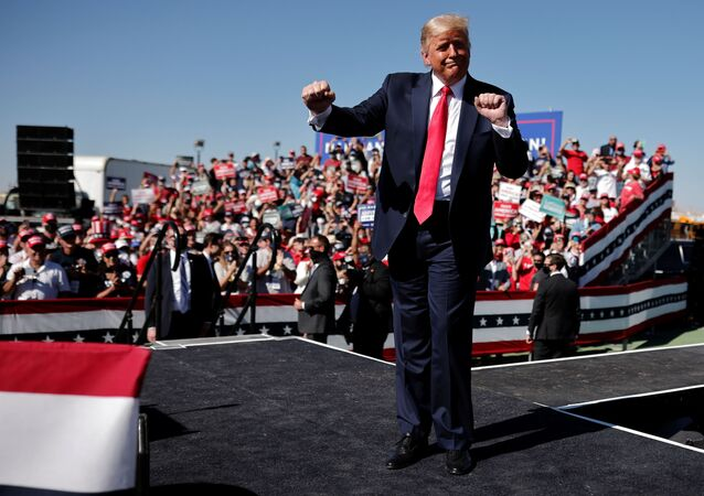 U.S. President Donald Trump gestures as he attends a campaign rally at Prescott Regional Airport, in Arizona, U.S., October 19, 2020. REUTERS/Carlos Barria