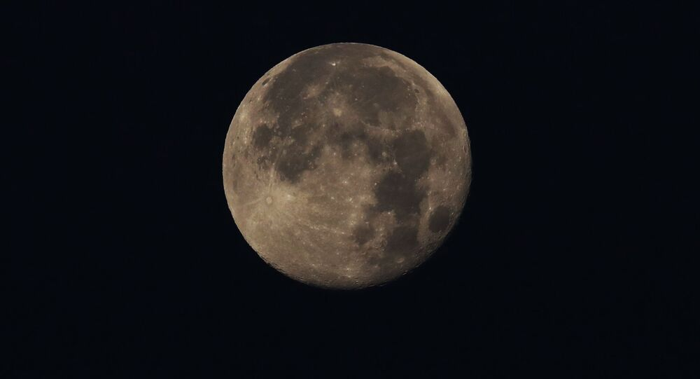 The moon hovers over in Mexico City, Friday, May 8, 2020. Mexico woke up to news of its largest one-day increase in confirmed cases of COVID-19, from Wednesday to Thursday