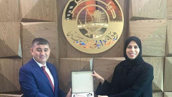 Katar Dışişleri Bakanlığı Sözcüsü Lulva el-Hatır (sağda), Türkiye'nin Doha Büyükelçisi Mustafa Göksu (solda) ile bölgedeki gelişmeleri görüştü. - Sputnik Türkiye