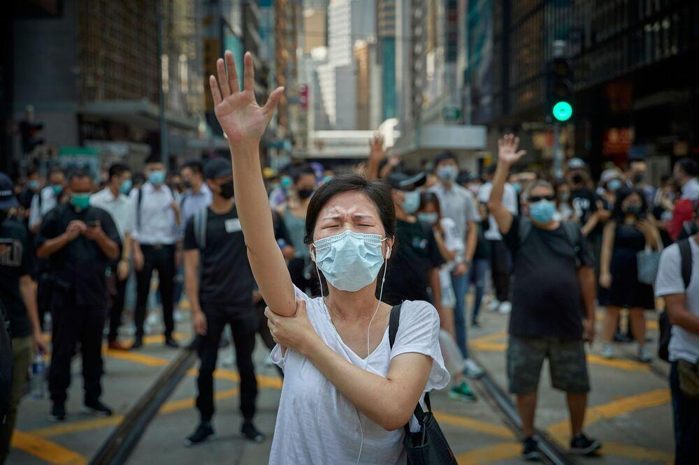 Yarışmada profesyoneller arasında Yılın Basın Fotoğrafçısı Ödülünü kazanan Fransız fotoğrafçı Kiran Ridley'in fotoğrafında Hong Kong'da düzenlenen Pekin karşıtı gösteriler görüntülendi