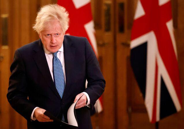 Başbakan Boris Johnson, AB ile Brexit ticaret anlaşmasını duyurduğu basın toplantısına gelirken