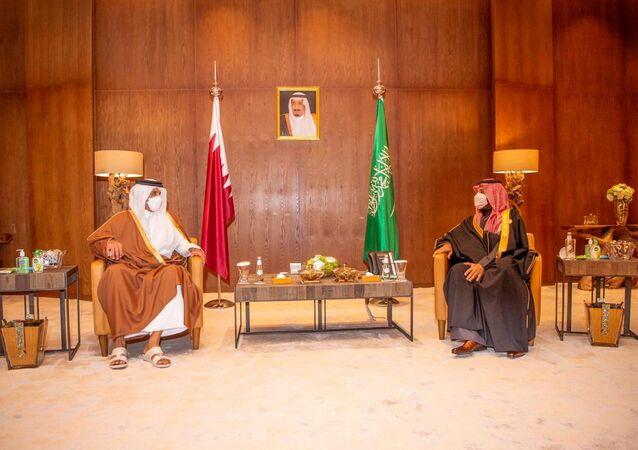 Saudi Arabia's Crown Prince Mohammed bin Salman meets Qatar's Emir Sheikh Tamim bin Hamad al-Thani during the Gulf Cooperation Council's (GCC) 41st Summit in Al-Ula