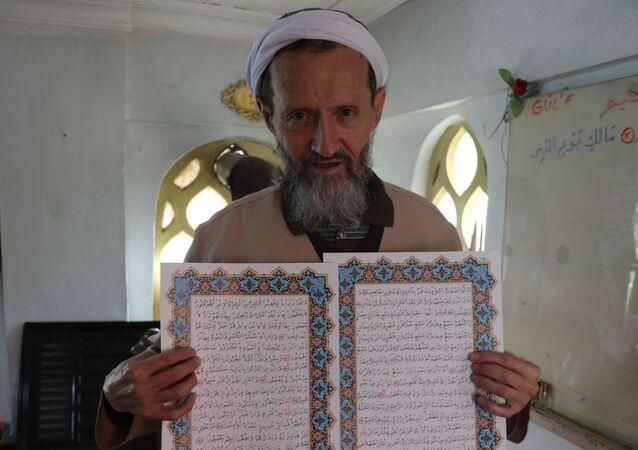El yazması Kur'an-ı Kerim yazan Lokman Aslan