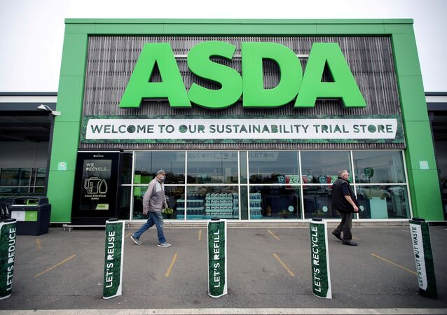FILE PHOTO: Shoppers walk past the UK supermarket Asda, in Leeds, Britain, October 19, 2020. REUTERS/Molly Darlington/File Photo