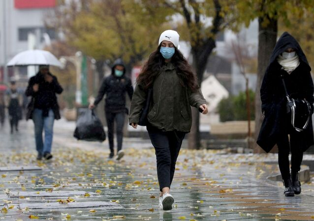 : People walk on a street after Tehran reopened following a two-week shutdown, amid the coronavirus disease (COVID-19), Iran December 6, 2020. Majid Asgaripour/WANA (West Asia News Agency) via REUTERS ATTENTION EDITORS - THIS IMAGE HAS BEEN SUPPLIED BY A THIRD PARTY./File Photo/File Photo