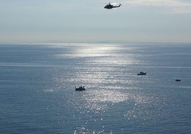 Gökçeada'da alabora olan teknede olan kişileri arama çalışmaları, Çanakkale