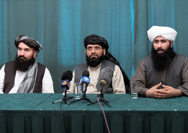Members of the Taliban delegation: former western Herat Governor Khairullah Khairkhwa, member of the negotiation team Suhail Shaheen and spokesman for the Taliban's political office Mohammad Naeem attend a joint news conference in Moscow, Russia March 19, 2021