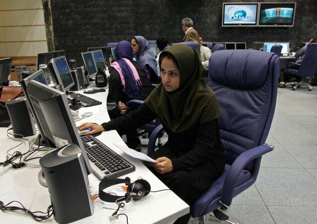 Iranian staff members of Press TV news channel work at the newsroom in Tehran, 20 June 2007