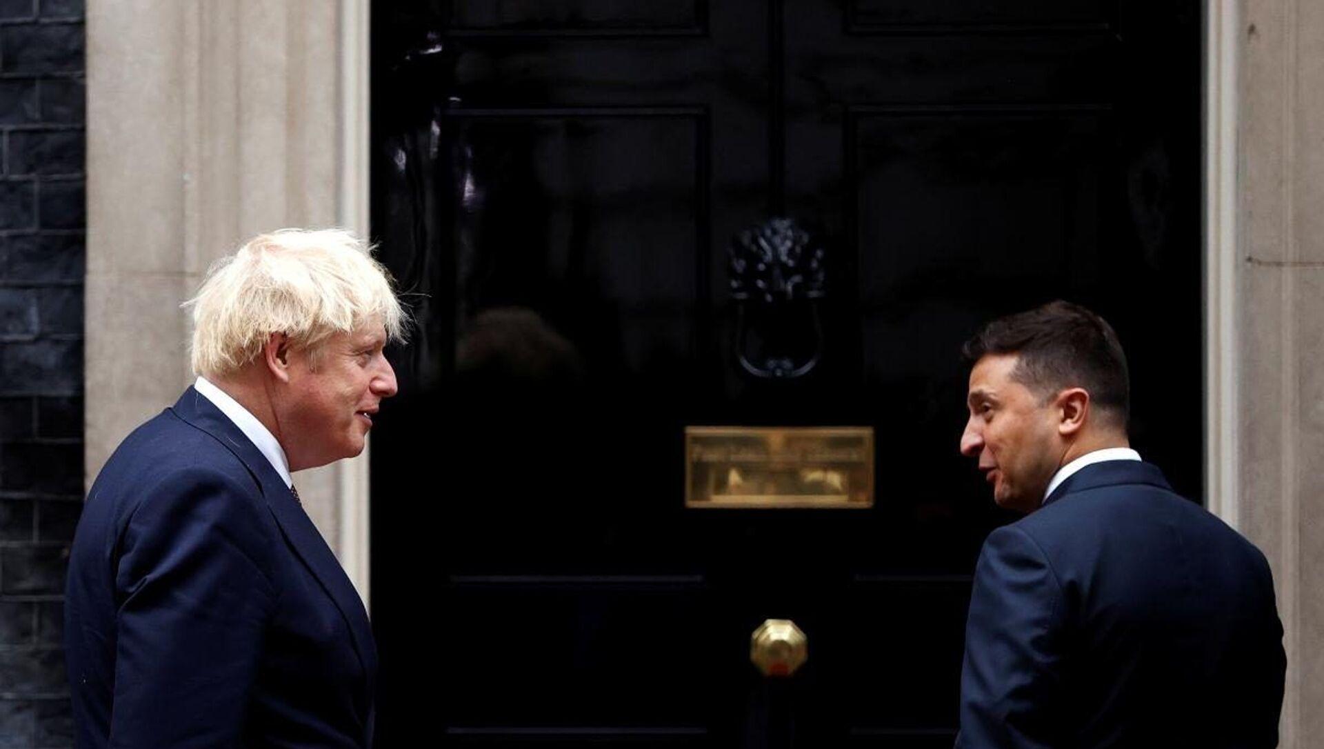 İngiltere Başbakanı Johnson - Ukrayna Devlet Başkanı Zelenskiy - Sputnik Türkiye, 1920, 06.04.2021