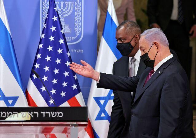 U.S. Defence Secretary Lloyd Austin and Israeli Prime Minister Benjamin Netanyahu arrive to give a statement after their meeting in Jerusalem on April 12, 2021. Menahem Kahana/Pool via REUTERS
