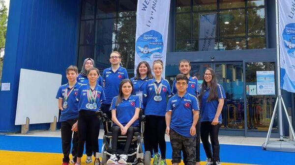 Paralimpik Yüzme Türk Milli Takımı, İtalya'da 14 madalya kazandı - Sputnik Türkiye