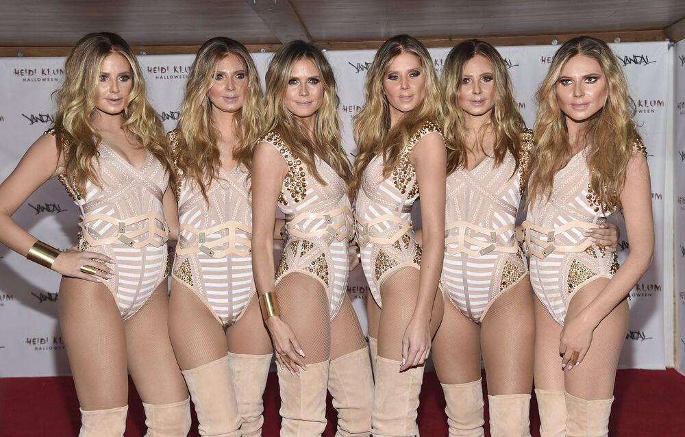 Dünyaca ünlü model Heidi Klum (soldan üçüncü olanı) ve kendisine benzeyen kadınlar, New York'taki etkinlik sırasında