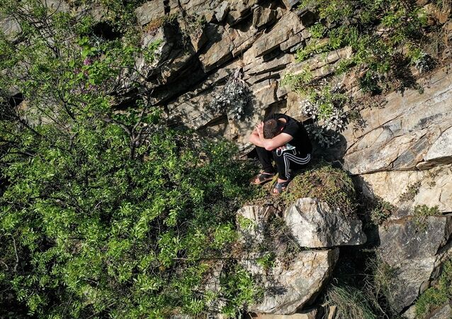 Bursa'da polisten korkup kaçan genç kayalıklarda mahsur kaldı