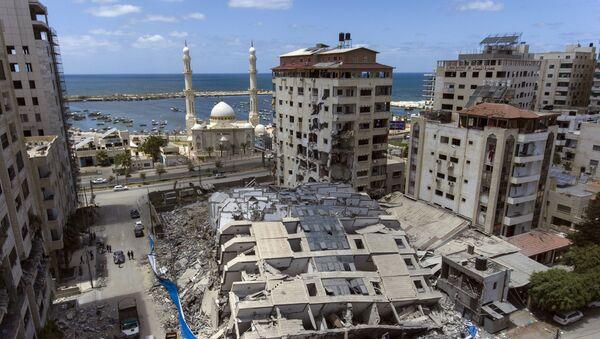 İsrail'in yıktığı Gazze'deki 13 katlı binanın sahibi, Uluslararası Ceza Mahkemesi'ne suç duyurusunda bulundu - Sputnik Türkiye